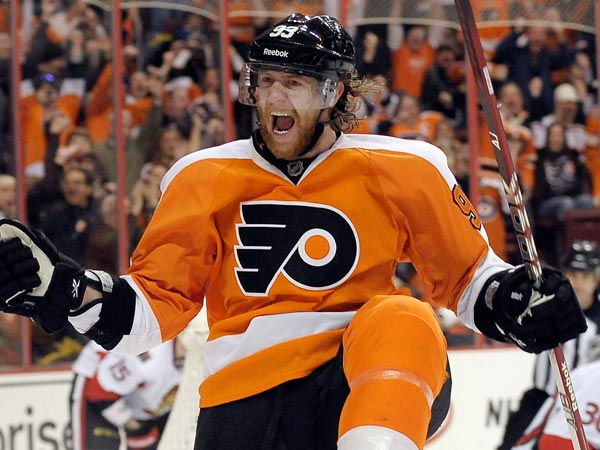 Jakub Voracek celebrates after scoring a goal past Ottawa Sentors´ Ben Bishop, right, during the second period of an NHL hockey game, Saturday, March 2, 2013, in Philadelphia. (Michael Perez/AP file)
