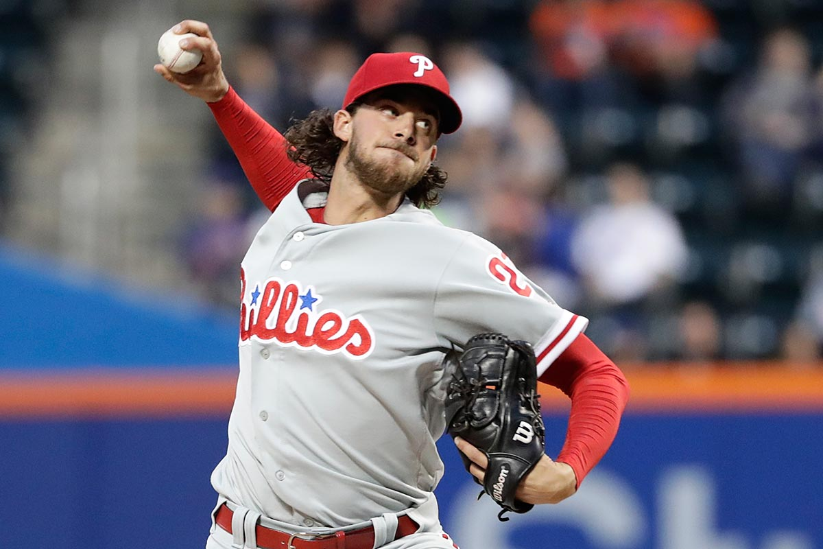 Philadelphia Phillies´ Aaron Nola (27) delivers a pitch during the first inning of a baseball game against the New York Mets Thursday, April 20, 2017, in New York.