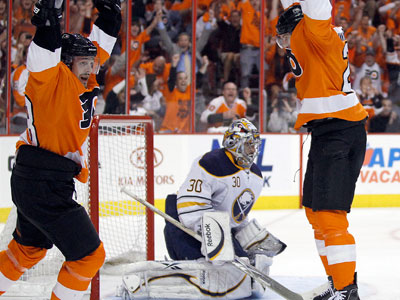 James van Riemsdyk and Danny Briere celebrate a second period power play goal in Game 7. (Yong Kim/Staff Photographer)