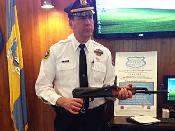 Firearms Identification Unit Lt. Joseph Walsh with AK-47.