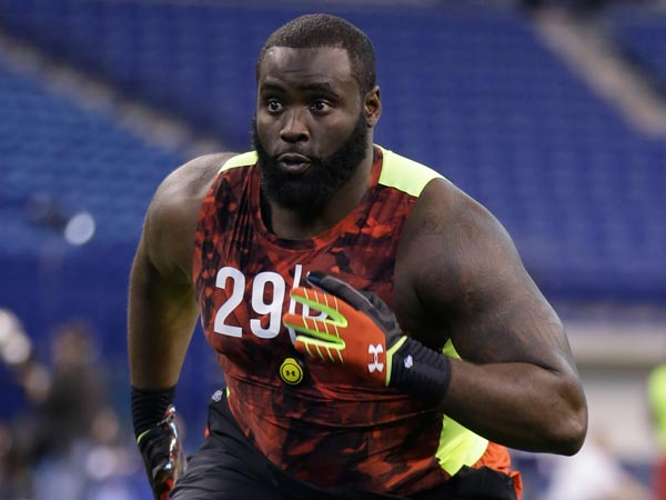 Eagles third round pick Bennie Logan running drills during the Scouting Combine. (Michael Conroy/AP file)