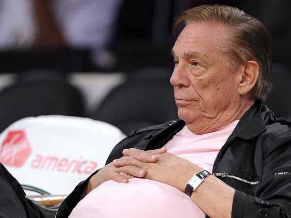 "FILE - In this Oct. 17, 2010 file photo, Los Angeles Clippers team owner Donald Sterling watches his team play in Los Angeles. The NBA is investigating a report of an audio recording in which a man purported to be Sterling makes racist remarks while speaking to his girlfriend.  NBA spokesman Mike Bass said in a statement Saturday, APril 26, 2014, that the league is in the process of authenticating the validity of the recording posted on TMZ´s website. Bass called the comments ""disturbing and offensive.""  (AP Photo/Mark J. Terrill, File)"