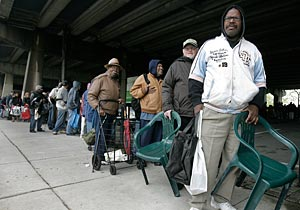 People brought chairs to wait in line - some for as long as four hours - for food from Philabundance in South Philadelphia today. (Akira Suwa / Staff Photographer )