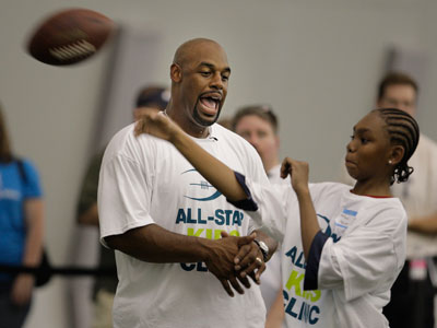"""We've been able to provide a fun, energetic, atmosphere for many kids over the years. That won't change just because my uniform has,"" said Donovan McNabb. (Ron Cortes / Staff Photographer)"