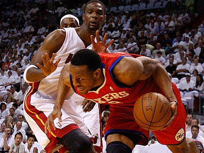 Andre Iguodala drives past Heat forward Chris Bosh during the first quarter of Game 5. (David Maialetti/Staff Photographer)