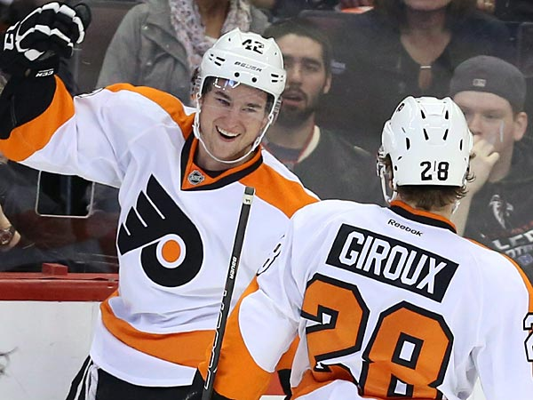 Philadephia Flyers´ Jason Akeson (42) celebrates his first NHL goal with teammate Claude Giroux (28) during the first period. (AP Photo/The Canadian Press, Fred Chartrand)