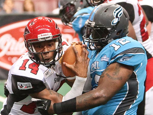 Soul defensive lineman Bryan Robinson tackling Jacksonville quarterback Bernard Morris. (Photo by Darryl Rule)