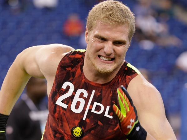 Joe Kruger runs a drill during the NFL football scouting combine in Indianapolis, Monday, Feb. 25, 2013. (AP Photo/Dave Martin)
