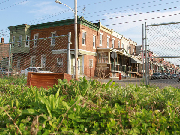 File photo: The large vacant lot at 1801 West Courtland St. is shown in the foreground with the homes on Gratz Street in the background on April 25, 2014. An audit raises the question of whether the city overcharged property owners for clearing vacant lots.  (CHARLES FOX/Staff Photographer)