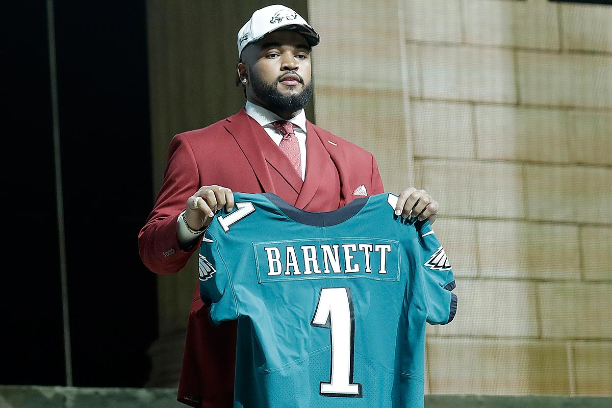 DE Derek Barnett holds his jersey after getting selected by the Eagles with 14th pick during the 2017 NFL draft.