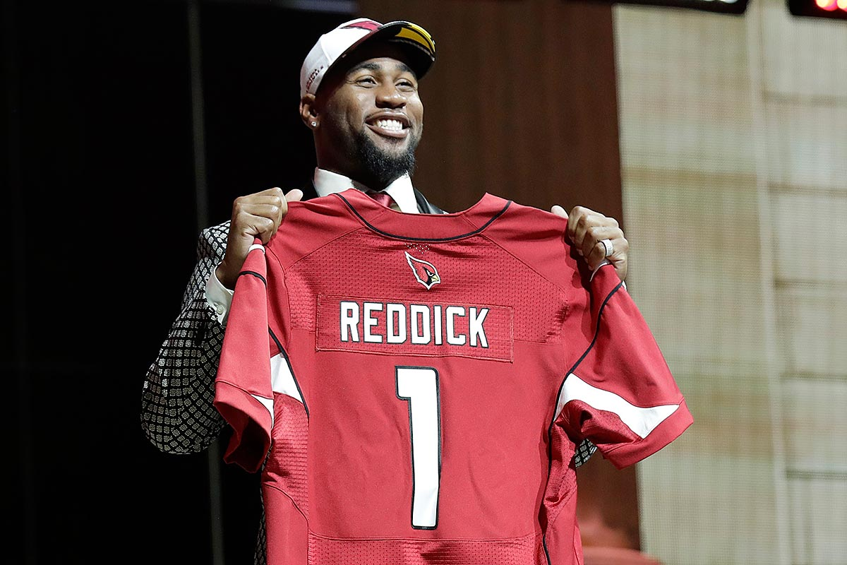 Haason Reddick holds his jersey after getting selected by the Arizona Cardinals 13th during the 2017 NFL draft.