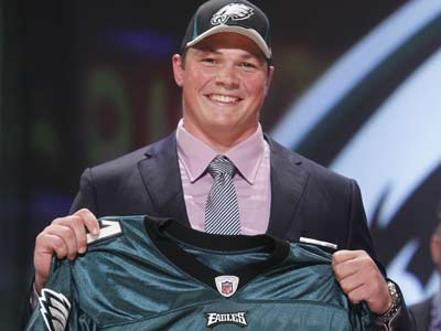 Baylor guard Danny Watkins poses for photographs after he was selected by the Eagles. (Jason DeCrow/AP Photo)