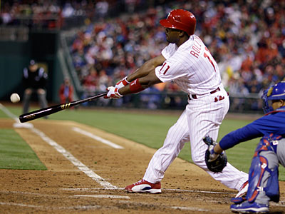 Phillies shortstop Jimmy Rollins hits a two-run double in the fourth inning on Saturday. (Matt Slocum/AP)