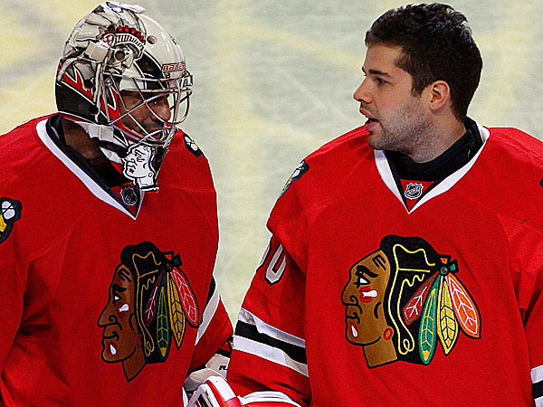 Ray Emery and Carey Crawford split the William M. Jennings Trophy after the Chicago Blackhawks gave up the fewest goals in the NHL this season. (Charles Cherney/AP)