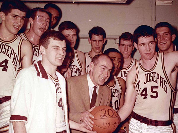 Saint Joseph´s University shows the school´s basketball coach Jack Ramsay, center, when his team won his 200th career game.. (AP Photo/Saint Joseph´s University)