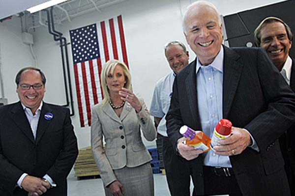 File photo: Republican presidential candidate, Sen. John McCain, R-Ariz., foreground, tours the National Label Company in Lafayette Hill, Pa, with his wife Cindy, second from left, and owner James Shacklett III, right, chief operating officer Dean Shacklett, left, and lead operator Martin Pieczynski, Monday, Aug. 4, 2008, .