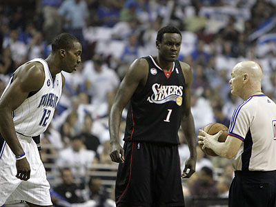 Dwight Howard was hit with a technical foul by referee Joe Crawford after elbowing Samuel Dalembert in Game 5 on Wednesday. Howard was suspended for Game 6 by the NBA today. (John Raoux/AP)