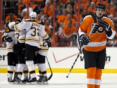 Flyers´ James van Riemsdyk skates away as the Bruins celebrate Mark Recchi´s second period goal. (Yong Kim/Staff Photographer)