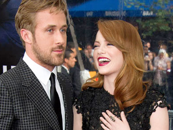 "Ryan Gosling (who gets the final laugh) and Emma Stone arrive at the ""Crazy Stupid Love"" premiere in New York, Tuesday, July 19, 2011.  (AP Photo/Charles Sykes)"