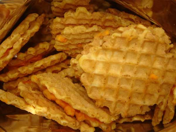 Potato chip giant Herr´s is buying a controlling interest in Silk City, which makes waffle-shaped snack like these.