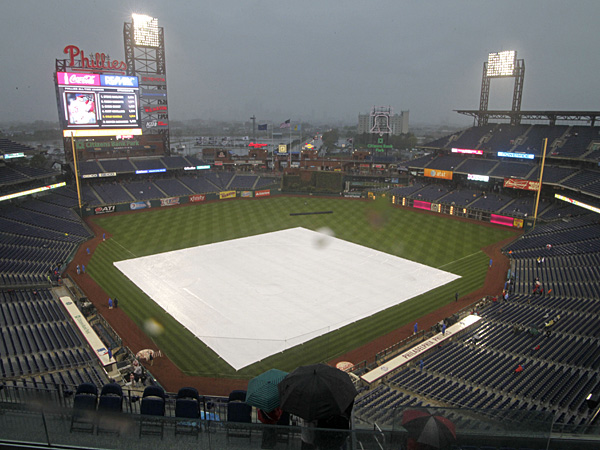 A tarp covers the infield as rain delays the start of a Phillies game at Citizens Bank Park. (H. Rumph Jr/AP)