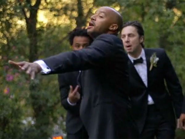 Donald Faison and Zach Braff (background) in the wedding video released by Martha Stewart Weddings. (screen grab)