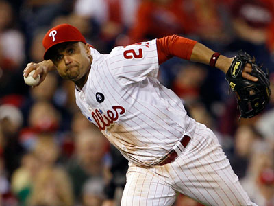 <br />Phillies&acute; Placido Polanco tries to throw out New York Mets&acute; Jose Reyes in the seventh inning on Sunday, May 1, 2011.  (Yong Kim / Staff Photographer)  <br />