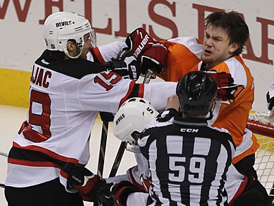 James van Riemsdyk mixes it up with the Devils´ Travis Zajac in the first period. (Michael Bryant/Staff Photographer)