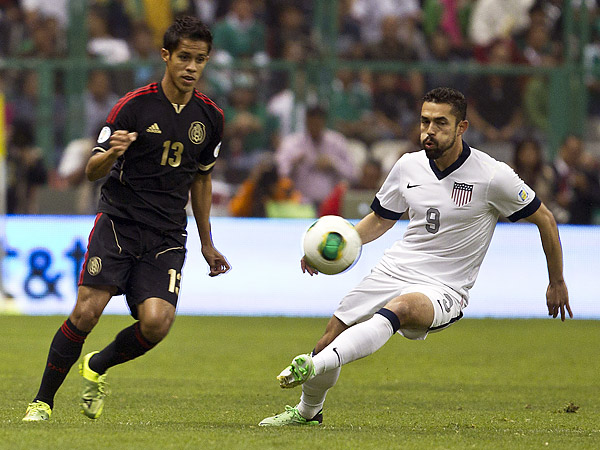 U.S. national team forward Herculez Gomez has expressed a desire to return to Major League Soccer, but the league´s roster rules make it hard for him to come back here. (Christian Palma/AP)