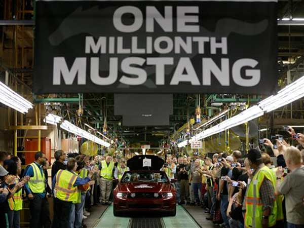 FILE - In this Wednesday, April 17, 2013, file photo Ford´s Flat Rock Assembly Plant employees cheer as the millionth Ford Mustang is driven off the assembly line in Flat Rock, Mich. The Institute for Supply Management issues its U.S. manufacturing index for April on Wednesday, May 1, 2013. (AP Photo/Carlos Osorio)