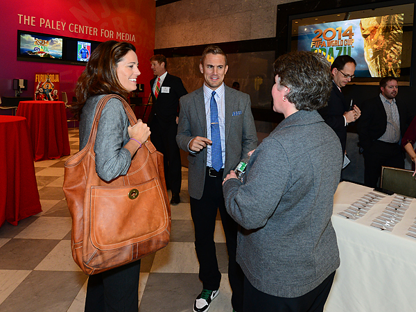 ESPN analysts Julie Foudy (left) and Taylor Twellman (center) chat with soccer producer Amy Rosenfeld (right) before the network´s World Cup presentation. (ESPN Images)