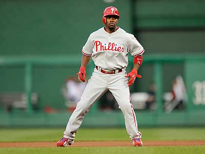 Jimmy Rollins is still experiencing pain in his strained right calf. (AP Photo/Nick Wass)