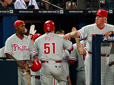 Carlos Ruiz drove in seven runs for the Phillies, but it wasn´t enough to get a win over the Braves. (John Bazemore/AP)