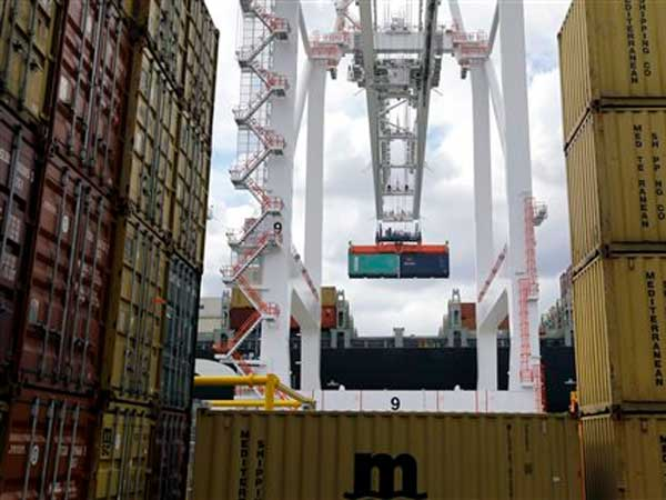 In this March 1, 2013 photo, a crane removes a container from a ship at the Port of Baltimore´s Seagirt Marine Terminal in Baltimore. (AP Photo/Patrick Semansky)