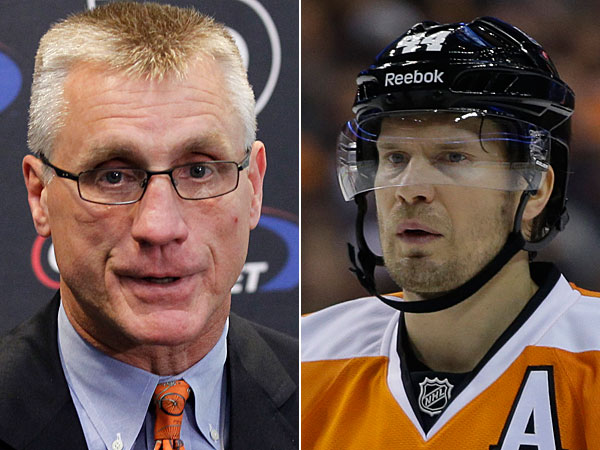 Flyers general manager Paul Holmgren and defenseman Kimmo Timonen. (Alex Brandon/AP) (Matt Slocum/AP)