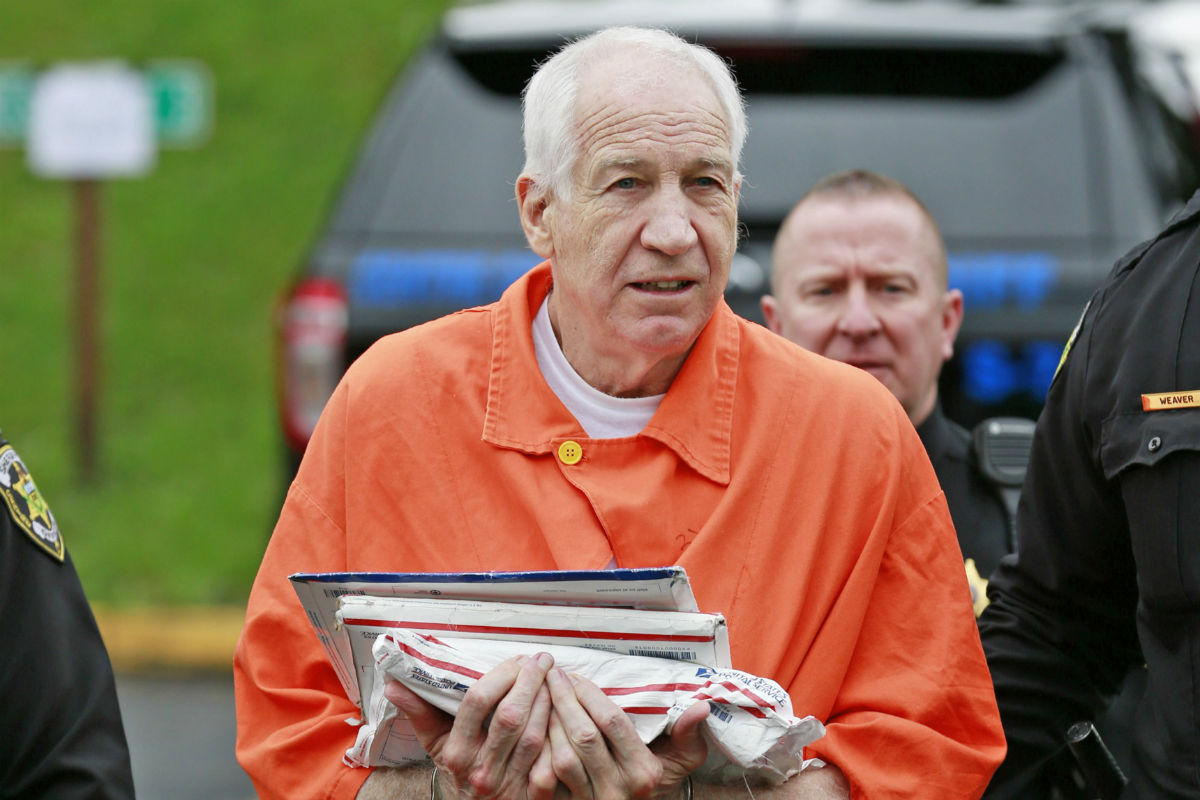 Former Penn State assistant football coach Jerry Sandusky is escorted into the Centre County Courthouse in Bellefonte, Pa., on May 2, 2016.
