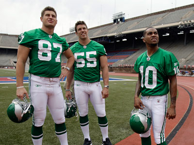 Brent Celek, left, Stewart Bradley, and DeSean Jackson model the kelly green throwback jerseys. (David Maialetti / Staff Photographer)