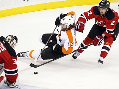 Scott Hartnell tries to move the puck past the Devils´ Marek Zidlicky during the second period of Game 3. (Yong Kim/Staff Photographer)