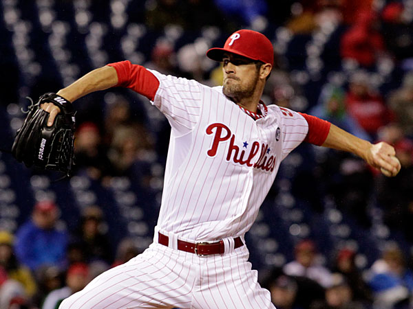 Cole Hamels winds up against the New York Mets in the first inning of a baseball game Tuesday, April 29, 2014, in Philadelphia. (H. Rumph Jr/AP)