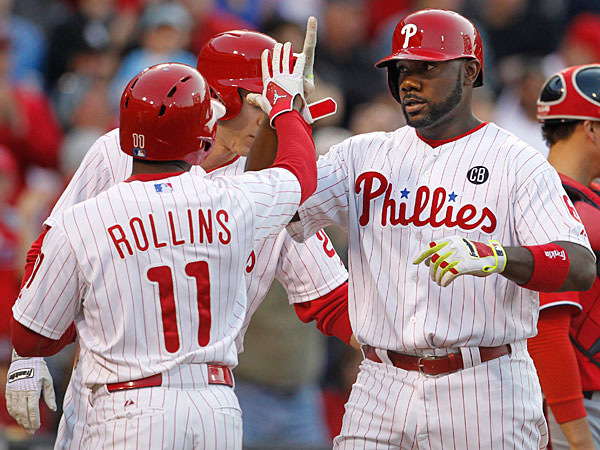 Ryan Howard is greeted by Jimmy Rollins and Chase Utley after<br />his three-run homer. (Ron Cortes/Staff Photographer)