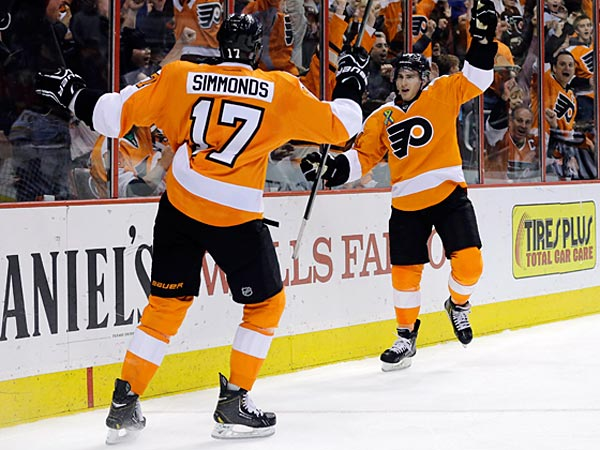 Philadelphia Flyers´ Matt Read, right, and Wayne Simmonds celebrate after Read´s goal during the second period of an NHL hockey game against the Boston Bruins, Tuesday, April 23, 2013, in Philadelphia. (AP Photo/Matt Slocum)