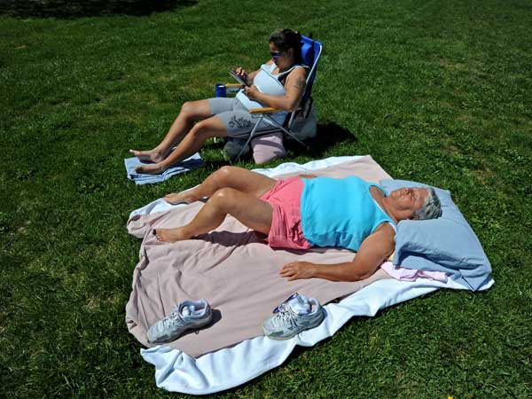 At Washington Lake Park in Sewell, Cindy Rodriguez, upper left; and Mary Bruce of Glassboro enjoyed the warm weather.  &quot;I need energy,&quot; explained Bruce, &quot;so I&acute;m getting in from the sun.&quot;  (April Saul /<br />Staff Photographer)