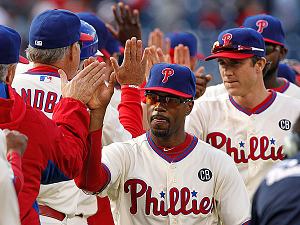 Phillies shortstop Jimmy Rollins and second baseman Chase Utley celebrate a win with teammates. (Ron Cortes/Staff Photographer)