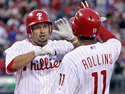 Shane Victorino celebrates his two-run home run with Jimmy Rollins in the third inning. (Steven M. Falk/Staff Photographer)