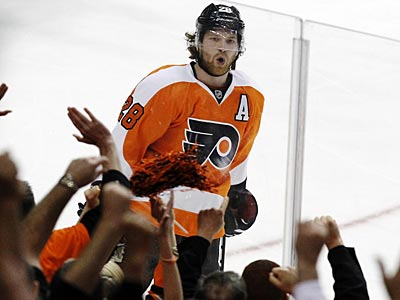 Claude Giroux and the Flyers open next season at home against the Bruins. (Alex Brandon/AP)
