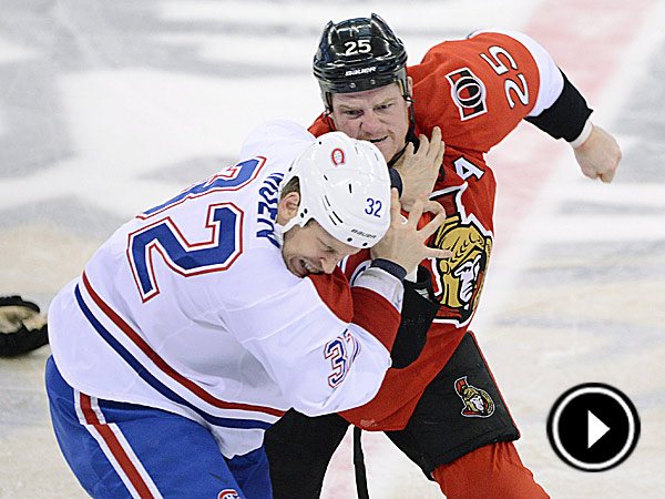 The Senators´ Chris Neil fights with the Canadiens´ Travis Moen during the first period. (Sean Kilpatrick/The Canadian Press/AP)