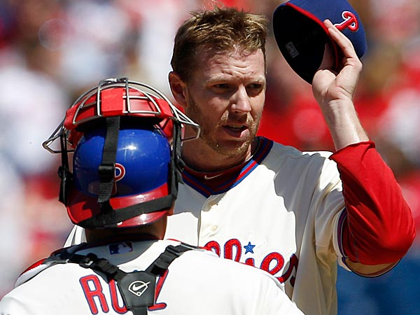 Phillies&acute; pitcher Roy Halladay takes off his cap with catcher Carlos<br />Ruiz after Miami Marlins&acute; Marcell Ozuna hit a three RBI double during<br />the first-inning on Sunday, May 5, 2013.  (Yong Kim/Staff<br />Photographer)