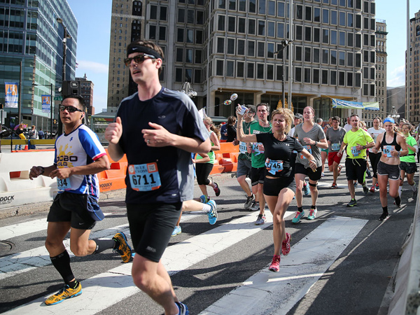 Runners make their way around City Hall during the Broad Street Run in Philadelphia on May 4, 2014. ( DAVID MAIALETTI / Staff Photographer )