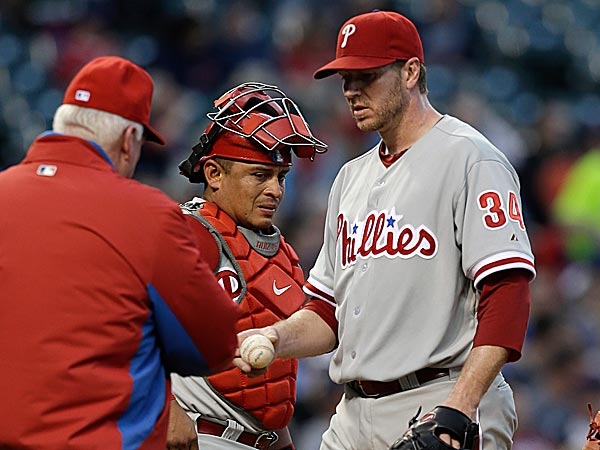 Roy Halladay, on the DL with right shoulder inflammation, will have his arm checked out by Dr. Lewis Yocum on Tuesday. (Tony Dejak/AP)