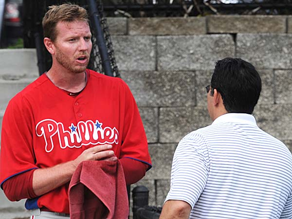 Phillies pitcher Roy Halladay and GM Ruben Amaro Jr. (Clem Murray/Staff Photographer)